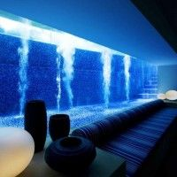 Stone lined pool from basement level at night. Oh stop!