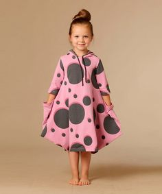 Fashion-forward girls will set schoolyard trends in this unique European design. Boasting an airy silhouette and a funky dot design, this piece features handy pockets and a protective hood.