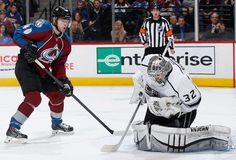 Goalie Jonathan Quick #32 of the Los Angeles Kings makes a save as Alex Tanguay #40 of the Colorado Avalanche