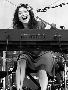 Regina Spektor. The only woman who can wear red lipstick right. I love her to death. Her piano playing is phenomenal!