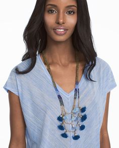 "Step up your tassel style with our tassel statement necklace featuring a mix of the season's most-requested blue fabric tassels and beads. Goldtone chain adds the perfect touch of shine.  Blue fabric tassel multi-row necklace Approx. 30 1/4"" overall length with 4"" extender; lobster closure Goldtone; acrylic; metal; cotton; glass; cubic zirconia Custom designed exclusively for WHBM. Handcrafted with nickel-free and lead-free metal."
