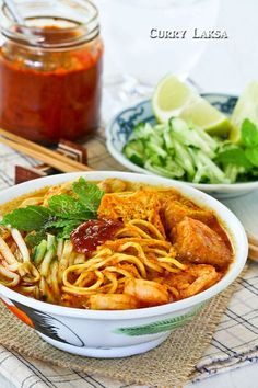Curry Laksa, a tasty and spicy Malaysian coconut based curried noodle soup topped with shredded chicken, shrimps, fried tofu, and bean sprouts.   RotiNRice.com