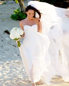 """A barefooted, beachy bride is a sure sign that the wedding's a romantic one—just ask Megan Fox. The actress escaped to Hawaii in Armani Prive's """"easy, breezy and ethereal dress,"""" describes Larson.  - from InStyle.com"""