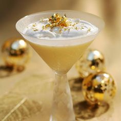 THE GOLDEN SNOWBALL MARTINI  (1 1/2 oz Absolut Vanilla Vodka  1/2 oz Cointreau  1/2 oz Marie Brizard White Crème de Cocoa  3/4 oz heavy whipping cream)
