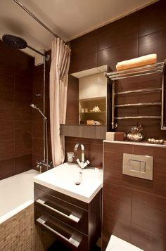 Elképesztő, hogy egy kis fürdőszobából mit ki lehet hozni. A színek és fények játéka egyszerűen csodákat tehet. A fények játéka a barna és bézs burkolatok úgy fel tudják dobni piciny fürdőszobánkat, hogy az olyan színben tündököl, mint valami csillogó luxus. A kellemes hangula ... Double Vanity, House Design, Interior Design, Mirror, Architecture, Furniture, Home Decor, Bathroom Ideas, Bathrooms
