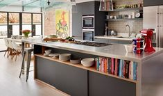 Open-plan kitchen neutral with colourful accessories... potencial conitnutaion from what we did in your lounge.