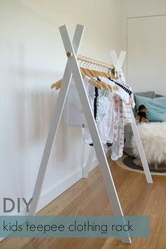 DIY teepee rack to display your kids' clothes. http://stylecurator.com.au/diy-kids-teepee-clothing-rack/comment-page-1/