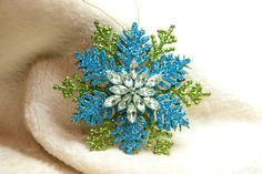 Handmade Christmas Ornament Teal and Green Glitter Snowflake with Brooch.  Again, I could do this!  So pretty!