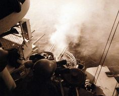 Battle for Iwo Jima, February-March 1945. Shown: Firing into cave on Mt. Suribachi by the 40 mm guns of USS Nevada (BB 36). Photographed by USS Nevada (BB 36), February 17, 1945. U.S. Navy photograph, now in the collections of the National Archives.