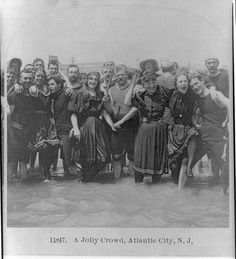 "The Atlantic City beach of New Jersey has been popular among beach-goers for a very long time. Here is a large group of swimmers enjoying the cool water back in 1897. At the time, women's ""bathing suits"" were essentially just shorter-than-usual wool dresses and they also had to wear wool stockings to maintain their modesty."