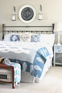 Master bedroom with shades of blue and white - www.goldenboysandme.com