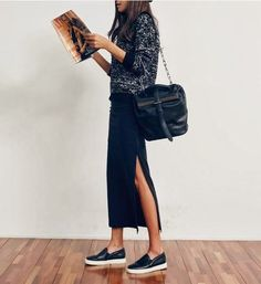 Slip-on sneakers and a sweater make a maxi skirt work for fall and winter.