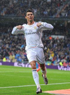 Cristiano Ronaldo celebrates after scoring his team's opening goal during the La Liga match between Real Madrid CF and Rayo Vallecano de Madrid at Estadio Santiago Bernabéu on March 29, 2014 in Madrid, Spain.