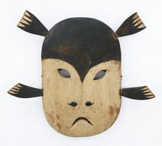 Lot 89- Old Yupik Seal Mask 8''x9''. An early carved wood and polychrome painted mask with four applied wood fins. Two fins have old glue repairs and paint has scattered chipping. Early to mid 20th century, Alaskan Eskimo Inuit Inupiaq. Collection of artist Danny Pierce, Washington.