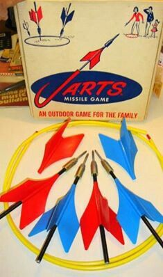 Jarts....yes our parents let us throw giant metal darts at each other.