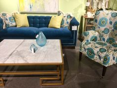 Teals, gold with stone, florals, geometric table design (Lillian August showroom at Furnitureland South in NC)