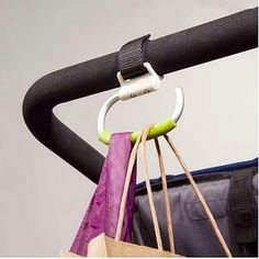 This simple stroller hook provides the extra hand that parents need. | 31 Products Every Parent Of A Growing Child Will Want