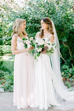 Beautiful bride + her bridesmaid | Photography: Kayla Yestal