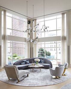 Perfection. Spaces. Creative and social spaces. Love the mix of furniture and chairs. And oh... The views.