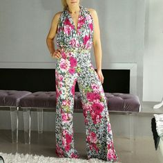 "Sexy Floral Jumpsuit Brand new, no tags Boutique item, Price is firm   Bold black, white and floral print jumpsuit featuring, sexy halter top neckline, open back, wide legged pant and includes gold chain belt. Pair with one of our chokers for a complete look!  Material has stretch, 95%polyester 5%spandex Small Length 57"" Medium Length 57"" Large Length 57     *Floral romper vacation getaway cruise party special occasions mothers day party pink hot gray white chain belt   Pants Jumpsuits…"