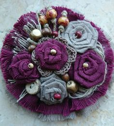 a pin made out of textile materials