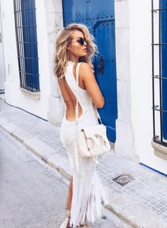 Women who are a pear shape with small boobs look incredible in a low cut backless dress. It accentuates your bum and takes draw attention away from a small bust. | Best Outfits for Flat Chested Women