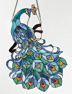 Shop for Chloe Tiffany Style Peacock Design Stained Glass Window Panel Suncatcher. Get free delivery On EVERYTHING* Overstock - Your Online Home Decor Outlet Store! Stained Glass Birds, Faux Stained Glass, Stained Glass Panels, Stained Glass Projects, Stained Glass Patterns, Leaded Glass, Beveled Glass, Peacock Art, Peacock Design