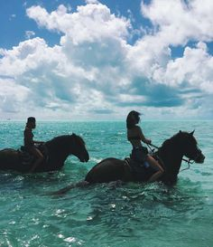 A perfect summer day riding horses and the cool ocean water