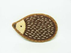 Friendly hedgehog felt pin - small size - made to order. $8.00, via Etsy.