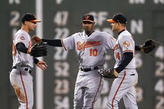 Craig Gentry Photos Photos - Joey Rickard #23, Adam Jones #10 and Craig Gentry #14 of the Baltimore Orioles embrace after their victory over the Boston Red Sox at Fenway Park on May 1, 2017 in Boston, Massachusetts. - Baltimore Orioles v Boston Red Sox