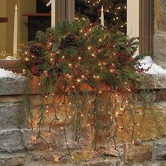 Add fresh hanging greenery and lights to your window boxes for a very elegant & natural look!