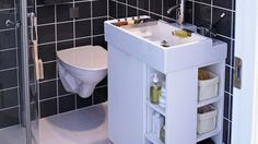 Smart-Storage-Solutions-for-Small-Bathrooms_01 WAY too modern for my tastes but I like how the cubbies face both front and side, perfect for next to a toilet in a normal vanity set up.  Might have to incorporate this!