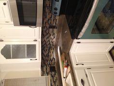 White cabinets, mosaic tile backsplash