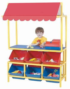 Market Stall: Brightly colored awning invites shoppers to browse and buy from the 6 x-Size Cubbies displaying today's wares at the preschool level. A wide counter encourages trades and commerce. ABS snap-together plastic components easily assemble with tool provided.