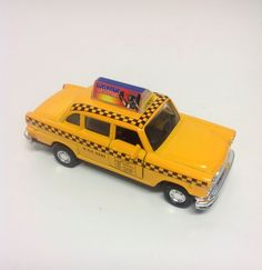 PULL BACK YELLOW TAXI. 2 Front Doors Are Opening. And A Welcome Sign On Top Of The Cab. Item dimensions: weight: 5, width: 180, height: 120 hundredths-inches. Manufacturer minimun age: 36 months.