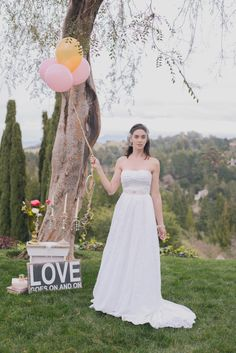 Adding balloons to create a playful feel - Wedding Dress by Ju.Lee Collection juleechic.com | Photo by Alyica Creative | Set Design by Your Vintage Affair Wedding & Event Rentals | Coordination by Blissful 2 Be #wedding #weddingdress #bridalgown #bridaldress #bridal #dress #juleechic #bride #bridetobe #weddingplanning