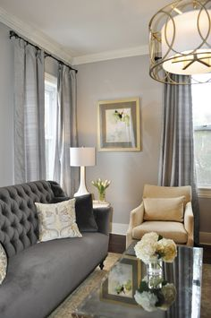 gray traditional living room, elegant gray living room, tufted sofa, gold accents, mirrored table Design by JWS Interiors www.jws-interiors.com Design Firm and Daily Design Blog