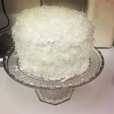 Coconut cake made for my dad for Father'd Day. Very yummy and very moist.  ~ white cake from Betty Crocker  ~ whipped cream frosting from Betty Crocker  ~ sweetened coconut shavings Follow the instructions from back of the box.  I whipped the wet ingredients together until frothy, just to make sure the eggs are incorporated nicely and preventing from over mixing the batter. Sprinkle the dry ingredients and mix for 30 sec.  I used a smaller pan. (5inch)  This cake has 4 layers, 1 1/2 cans frostin Yummy Treats, Delicious Desserts, Dump Cakes, Whipped Cream Frosting, Cake Making, Betty Crocker, Frostings, How To Make Cake