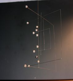 This cool Mid Century Kinetic mobile with silver balls adds movement and fun to any modern space. So hard to find these original mobiles! Made in Japan Mobile Art, Hanging Mobile, Hanging Art, Alexander Calder, Mobiles, Mobile Sculpture, Kinetic Art, Wire Art, Wind Chimes