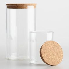 These slim glass canisters are excellent storage for bathroom necessities or decorative accents. Both canisters come with a cork top that coordinates with any bathroom decor.