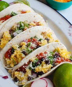 Make these Southwest Breakfast Egg Tacos for a protein packed breakfast, lunch or dinner! These tacos use eggs as the base and pair your favorite Southwest ingredientsincluding black beans, cheese, cilantro, salsa and red onion. Your whole family will love these!// acedarspoon.com #eggs #tacos Brunch Recipes, Breakfast Recipes, Breakfast Ideas, Easy Recipes, What Is A Taco, Cilantro Salsa, Recipes With Flour Tortillas, Breakfast Wraps, Tortilla Recipe