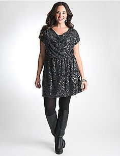 Make a dramatic entrance in our sequin-embellished dress. Figure-flattering and perfect for that special night out, this sassy knit dress shows curves to their best advantage with a draped neckline, short sleeves and elastic waist. Versatile length is equally stylish as a dress or tunic layered over tights for a pop of color. lanebryant.com