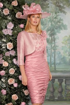 90402 (Condici) A pretty silk dress and matching jacket in Rosebud and Porcelain/French Navy. The dress has a delicate lace overlay to the bodice and sleeve with intricate embroidered detailing. The skirt is ruched which flatters the figure and the Read More...