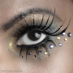 Mystical look. Love the gems and hint of color. #halloween #makeup