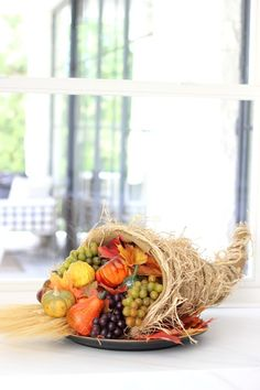 A cornucopia is the quintessential Thanksgiving decoration piece. While you can purchase a ready-made one, making your own is easy and affordable.