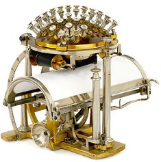 It's an early typewriter - The Malling-Hansen Writing Ball patented in 1870