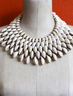 Cowrie 5 Necklace by MusoMasiri on Etsy Shell Jewelry, Shell Necklaces, Clay Jewelry, Beaded Jewelry, Beaded Necklace, Handmade Jewelry, Diy Fabric Jewellery, Fulani Earrings, Maxi Collar