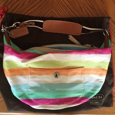 NWOT Coach hamptons watercolor large hobo Has two inside slip pockets and one inside zip pocket. One outside slip pocket. Zipper track and pull are lined in taupe suede. Colors are light blue, lime, orange,white, magenta and a dark mint green. Roughly 15 inches long and 10 inches high. Comes with a coach dustbag. NO TRADES! Coach Bags Hobos