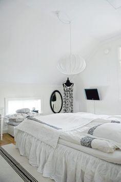 dreaming in white bedroom