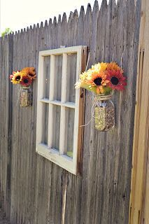 piece of fencing - to lean against the wall behind the bride/groom table and had the heart and arrow with sunflowers on i